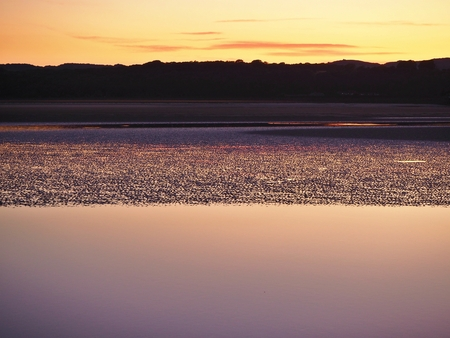 Beautiful yellow and purple sunset over the Kent Estuary, Arnside, Cumbria Stock Photo