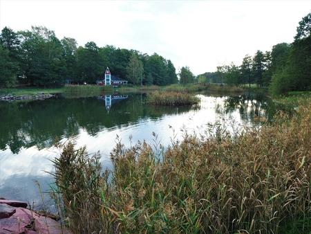 Scenic lake and building in Lilla Holmen park, Mariehamn, Aland, Finland