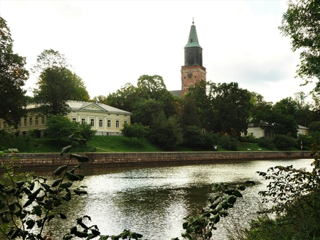 View over the River Aura to an elegant house and the Cathedral in Turku, Finland