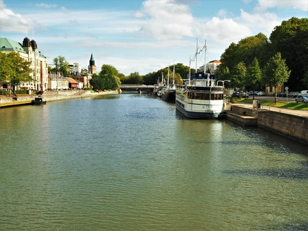River Aura in the city of Turku, Finland, with boats and riverside buildings