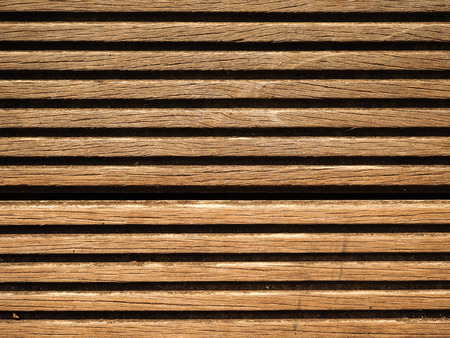 Closeup of wooden decking board with horizontal slats as a background