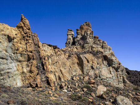 Rock strata at Roques de Garcia in the Teide National Park in Tenerife, Canary Islands, Spain, with a clear blue sky Stock Photo