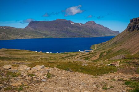 View over the tiny settlement of Djupavik to a fjord and mountains in the Westfjords of Iceland
