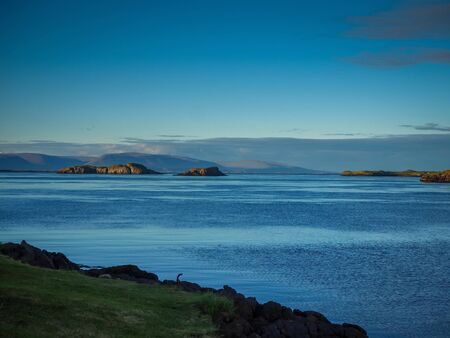 Evening view from the coast at Stykkisholmur on the Snaefellsnes Peninsula, Iceland Фото со стока