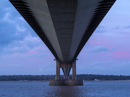 View of the Humber Bridge from below just before sunset, North Lincolnshire, England