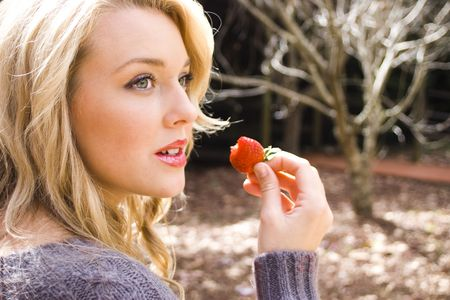 eating a strawberry photo