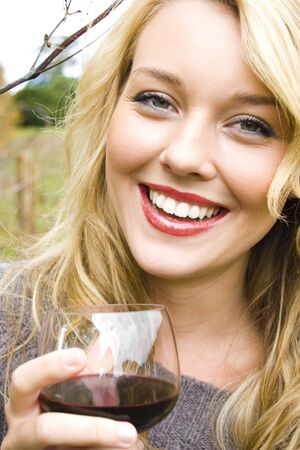 woman drinking wine at the vineyard Stock Photo
