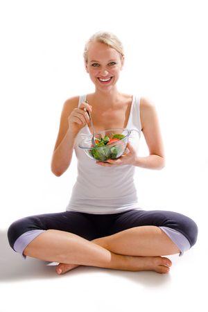 beauiful girl eating salad