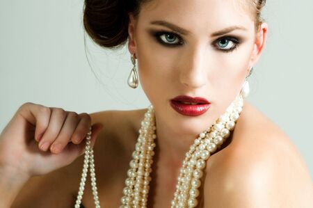 Attractive young woman wearing a pearl necklace and earrings. Horizontal shot. Stock Photo - 6505239
