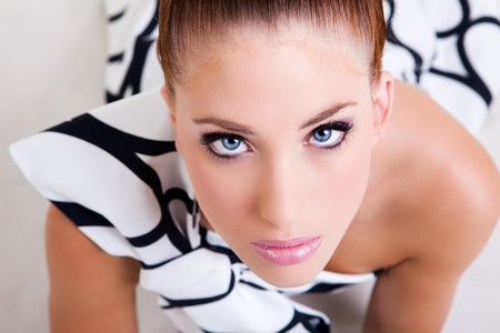 High angle portrait of an attractive young woman in a black in white dress. Horizontal shot. Stock Photo