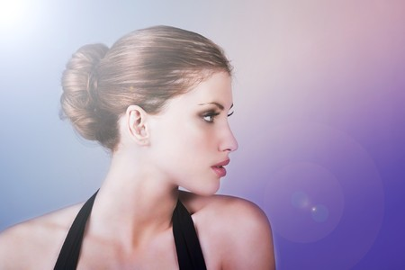 Side view of attractive young woman wearing a hair bun. Horizontal shot. photo
