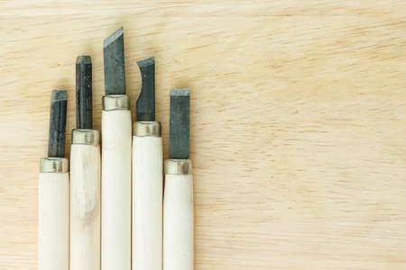 hand tool: chisel carving set on wooden background