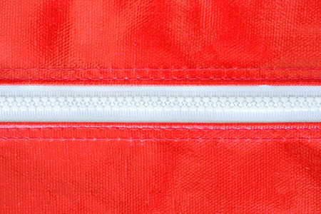 red bag: white zipper on red bag Stock Photo