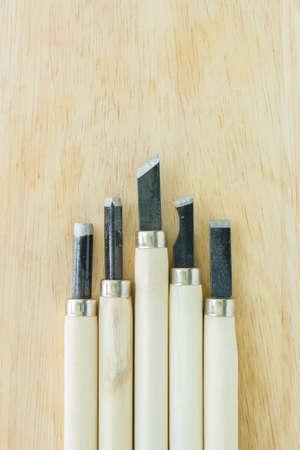 gouge: chisel carving set on wooden background