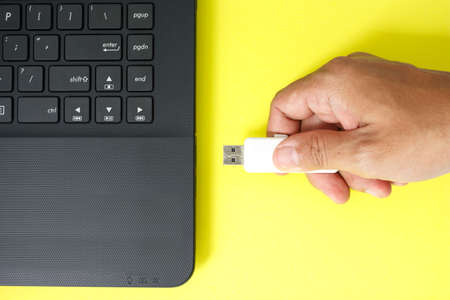 usb flash drive memory stick on yellow background