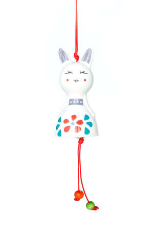 figurines: wind chimes cat figurines on white background Stock Photo