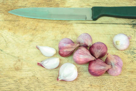 onion red: red onion sliced on wooden cutting board