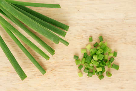 green onion: green onion cutted chives nature food on wood cutting board background