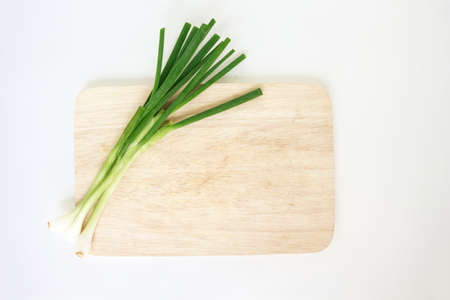 green onion: green onion vegetable cutting board nature food on white background