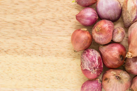 red onion: red onion sliced on wooden cutting board