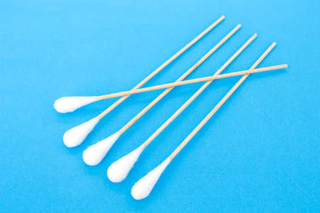 cotton bud: cotton bud, swab clean healthcare top view on blue background Stock Photo