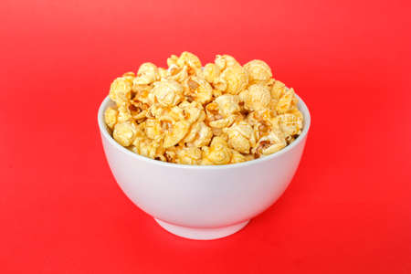 popcorn white bowl on red background