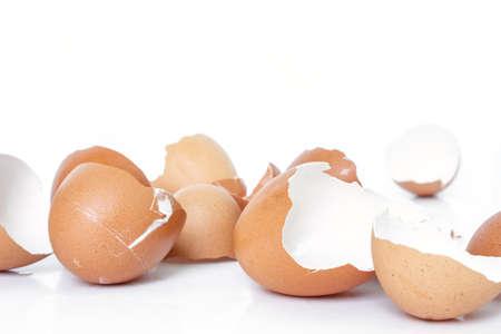 an egg shell: egg shell broken crack pile food on white background Stock Photo