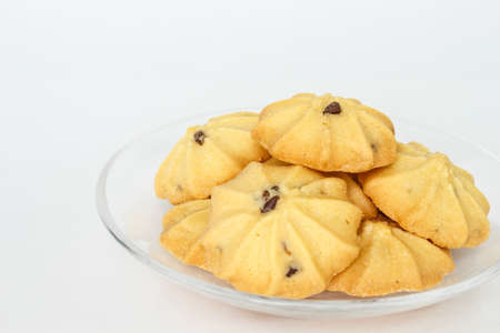chocolate chip cookies biscuits on plate on white background Stock Photo