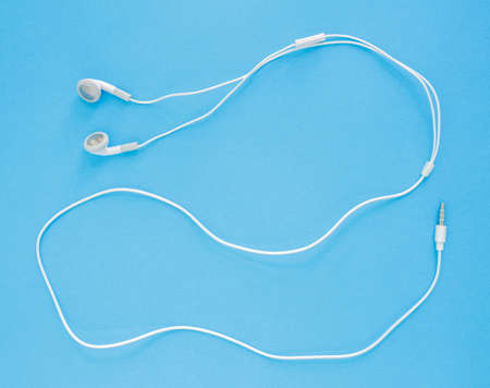 earbuds or earphones on blue background