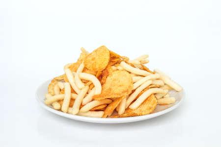 plato del buen comer: comida rápida o comida chatarra en la placa blanca, no comer para una buena salud. Foto de archivo