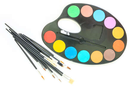 paint tray and paint brush on white background. Stock Photo