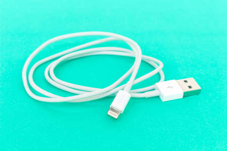 usb cable port charger on green background