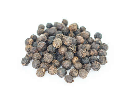 peppercorns: black peppercorns heap on white background.