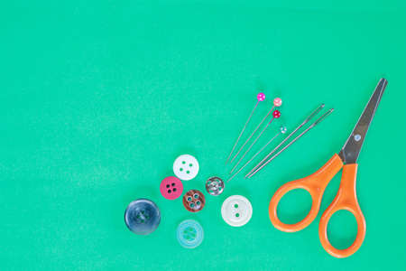 accessory sewing on green background. Stock Photo