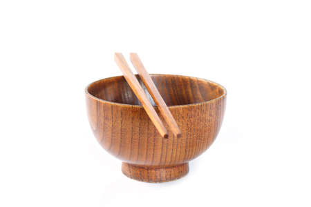 bowl and chopsticks wooden on white background. Stock Photo
