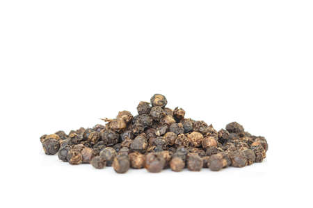 black peppercorns heap top view on white background. Imagens