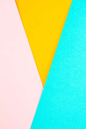 paper color yellow, pink and green abstract background.
