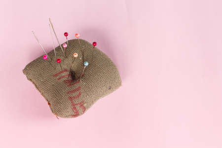 sewing pins on pink background. Banco de Imagens