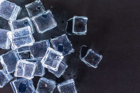 group ice cubes on black background.