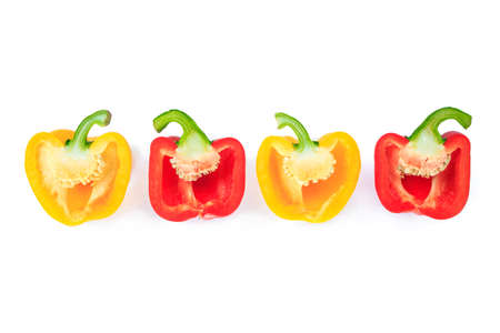 red and yellow bell pepper cut half into pieces on white background, top view. Stok Fotoğraf