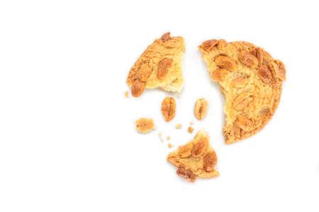 peanut cookie broken on white background.