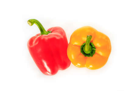 red and yellow bell pepper on white background. Archivio Fotografico - 128962811