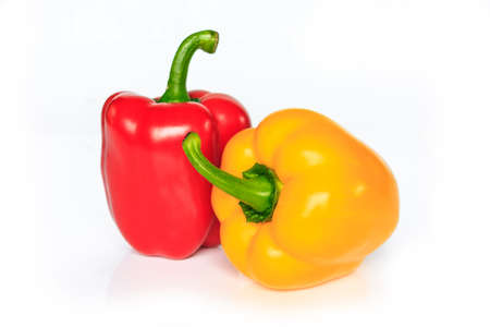 red and yellow bell pepper on white background. Archivio Fotografico - 128962912