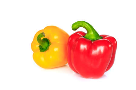 red and yellow bell pepper on white background. Archivio Fotografico - 128962933