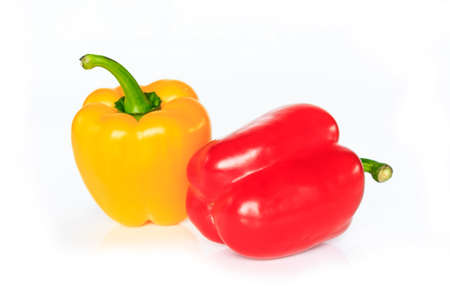 red and yellow bell pepper on white background.
