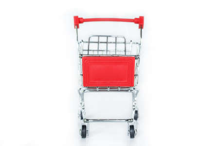 red shopping cart on white background. Archivio Fotografico - 128963337
