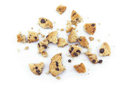 Cookies chocolate broken into pieces on white background.