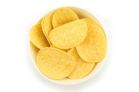 potato chips on bowl on white background.