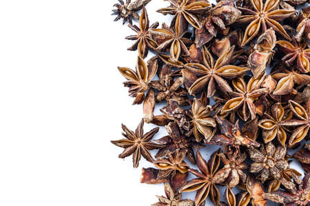 heap star anise top view on white background.