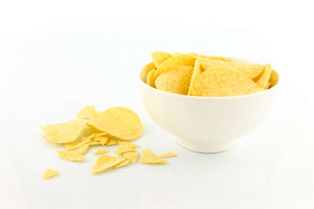 potato chips on bowl on yellow background.